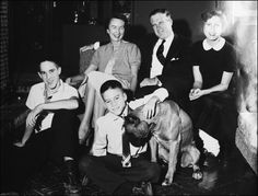 Members of the Romney family in their home on Vaughan Road in Bloomfield Hills, Mich. Mitt is the youngest boy in the center, and he was petting the family dog, Bosco.  (Provided by The Bentley Historical Library, University of Michigan )