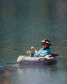 Relaxing out on the lake with my fishing pole in hand. I like her style!! This will be me in 30 more years, with a floating cooler behind me.