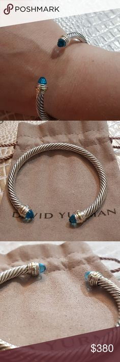 "NWOT David Yurman Cable Bracelet with Blue Topaz New without tags! David Yurman two toned sterling silver and 14k gold cable bracelet with blue topaz. End to end measures 6"" 5mm wide Comes with DY pouch  Ships same or next business day! PRICE FIRM David Yurman Jewelry Bracelets"