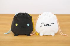 The cloth bags to be bundled with upcoming Neko Atsume character books are absolutely adorable