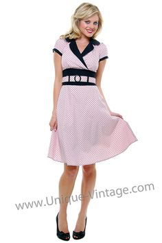 "Pink and black polka dot dress. Style is meant to accentuate the bust and tuck in the middle. 35"" long. $68."
