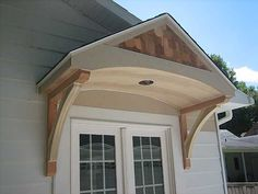 This portico would work for the front and side doors...
