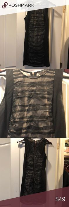 Armani exchange black mini dress Armani exchange black mini dress with lined overlay fabric on front and back     Back exposed rose gold zipper Armani Exchange Dresses Mini