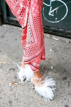 Spotted on the streets of New York, London, Milan and Paris, fur and feather shoes are everywhere this season. We love this street style look with a floral kimono. Have you tried this trend yet?