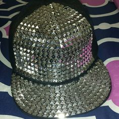 Studded Hat This hat has never been worn. It's black with studs. No studs are missing. It's also a snap back. Love Culture Accessories Hats
