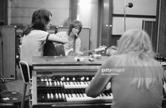 English progressive rock band Yes recording their 'Fragile' LP at Advision Studios in London, 20th August 1971. From left to right, singer Jon Anderson, bassist Chris Squire and keyboard player Rick Wakeman.