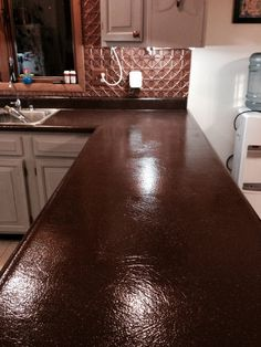 After:  Coffee Bean - Spreadstone Countertop Refinishing Kit - $125 from website (no shipping)