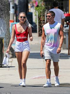 Summer holiday: Louisa Johnson was enjoying herself as she strolled along in the sunshine in Hollywood, California on Monday, wearing a rather racy bodysuit