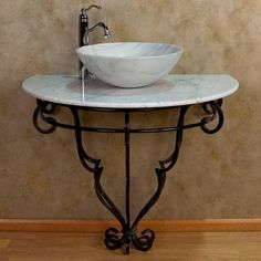 This wall mount wrought iron sink features a beautifully sculpted base that tapers to the ground, as well as a solid marble top suitable for the vessel sink of your choice. Description from houzz.com. I searched for this on bing.com/images