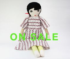 """Lumi doll is entirely handmade from cotton, wool, linen and polyester filling. Her features have been screen printed with water based inks.size:  about 21"""" high (53 cm)Made to order, Lumi is part of a limited edition.Please allow 2 to 3 weeks for your Lumi to be shipped.Each model is unique and might differ slightly from the picture shown.The dress is half lined and closes with a ribbon. Please note Lumi is not a toy, due to her delicate nature Lumi is suitable for older children only. Lumi…"""