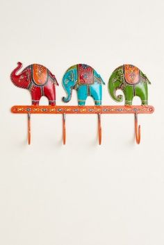 Artistically assembled and painted by hand in Jodhpur, India, this metal wall hook can be used to liven up any space! It has a colorful three-elephant design with vibrant details throughout. You can use this hand-painted wall hook to hang jackets, scarves, keys or even jewelry!