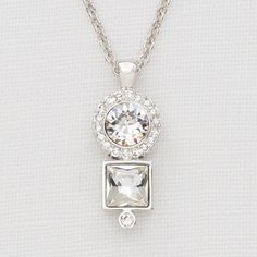 """Jewel of the Month: Spotlight Pendant   We're all about the sparkle this month with our Spotlight Pendant! Priced at $67.00, this eye-catcher features Swarovski crystals set in rhodium plating.  The Spotlight Pendant adds extra bling to an otherwise classic pendant.  This necklace gives you """"va-va-va-voom"""" in terms of versatility!  Wear it casual during the day or dress it up at night – either way, it's a head turner!"""