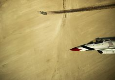 Capt. Jason Curtis, Thunderbird 6, Opposing Solo pilot, re-joins with the Diamond formation to perform the Delta Bottom-Up Pass during a practice sortie over the range near Nellis Air Force Base, Nev., March 11, 2013. shot by Ssgt Larry Reid/US Air Force