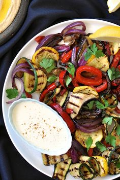 Chargrilled Vegetables with Garlic-Lemon Yogurt Sauce — a summery assortment of grilled veggies (summer squash, zucchini, bell peppers, onions, and eggplant) with a light, Greek-yogurt-based dipping sauce, via @recipetin