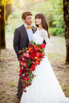 Call me old school. Not the flowers or the colors but I want a cascading boquet like this one!