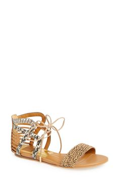 The cool mix of materials and the open tie-front design makes these the perfect summer sandal.