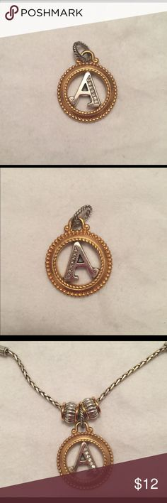 """Brighton initial A charm Brighton initial A charm   📯Two tone finish in gold & silver  📯Swarovski crystals on front of initial 📯Etched design on back of initial  📯Retired 📯1 1/16"""" in diameter 📯Big enough to make a great necklace pendant! 📯Like new condition  See design ideas in last photo. Shown with two gold and silver spacers.   **More Brighton beads, charms and jewelry in closet, including items in last photo. Add 2 or more listings to a Bundle and save 20% on all of them, plus pay…"""