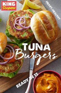 Tuna Burgers - QFC Cheryl Kolodzik cherigirl Fish Recipes This heart-healthy beef burger alternative, uses canned tuna combined with breadcrumbs, egg, celery and mayonnaise. For an even healthier take, skip the bun and serve it in a Bibb lettuce wrap Easy Tuna Burger Recipe, Tuna Recipes, Seafood Recipes, Cooking Recipes, Healthy Recipes, Healthy Foods, Recipies, Hamburger Recipes, Cooking Tips