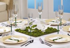I'm not sure what you call this...Moss Garden Butterfly centerpiece? But I love it!!!! This is such a unique idea, and will give your guests a great conversation piece. Learn how to make your own here.