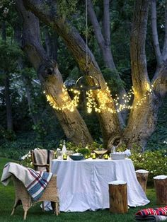 Crucial tips to throwing a summer shindig. Who wouldn't want this as their backyard?