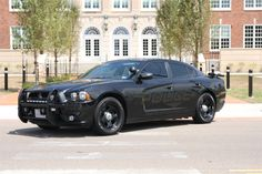 2012 Slick-top Dodge Charger PPV with ghost graphics and license plate readers.