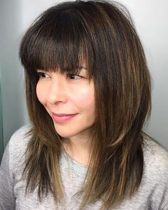 Mid-Length Straight Layered Cut with Bangs