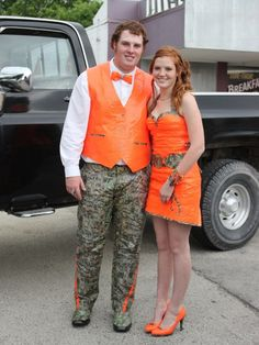 Stuck at Prom® Duck® Brand Duct Tape College Scholarship Contest - Even though I live in Ga, I'm not a fan of the camo and bright bright orange combos. But this is great! Her dress is amazing and they made a ton of their accesories using duck tape as well. His tux compliments her dress so well!