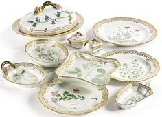 A GROUP OF ROYAL COPENHAGEN 'FLORA DANICA' WARES MODERN comprising: a large oval vegetable tureen and cover, a 15 3/4-inch oval platter, a 13-inch circular platter, a deep oval dish, a square shaped dish, a leaf-shaped dish, a pickle dish, two reticulated large dinner plates, a small circular sugar bowl and cover and a triangular custard cup and cover, standard printed and painted factory marks and shape numbers 20 3567, 373, 20 3527, 20 3506, 363, 20 3540, 20 3544, 20 3574, 20 3502, 20…