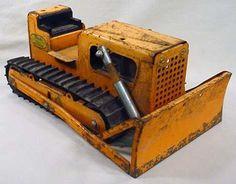 Tonka Bulldozer, ah the good ol' days, back when you might spilt your lip on the steel Tonka bodies.
