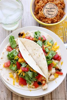 Margarita Chicken Tacos are the perfect weeknight meal! Fire up the grill and get dinner on the table in about 30 minutes. #tacos #grilling #chicken