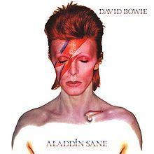 David Bowie:  Aladdin Sane.  I'll never forget this album cover-- Brock has a 6' x 4' poster of it in his house.  I've always wanted him to be this version of Bowie for Halloween!