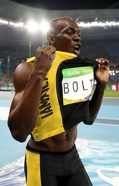 Usain Bolt of Jamaica celebrates winning the Men's 100 meter final on Day 9 of…