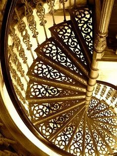 iron spiral stairs with gold finish