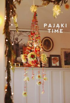 That expression there is the crux of the pajaki (prounounced Pie-Yonky). Pajakis are a traditional Polish folk art made to look like elaborate spiderwebs. The literal translation is spiders of straw. To you or me they look like paper chandeliers, but to spiders, apparently they look like big glitzy condominium.