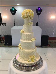 Spring wedding cake, lemon and pale ivory.