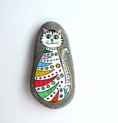 Hand Painted Stone Cat  Beach pebble with hand-painted designs in acrylics  © Sehnaz Bac 2015    I paint and draw all of my original designs