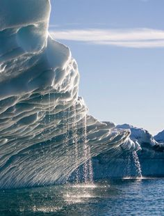 Melting water streams from iceberg in Disko Bay, Greenland | See more Amazing Snapz