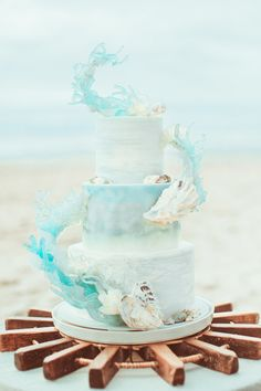 One of the most unique and artistic beach theme wedding cakes I've seen in a while (coming from a beach destination wedding stationery designer, I've seen a lot. Pretty Cakes, Beautiful Cakes, Amazing Cakes, Beautiful Beach, Ocean Cakes, Beach Cakes, Beach Theme Cakes, Beach Themes, Crazy Cakes