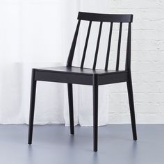 """Shop hemstad black chair.   Designed by Jannis Ellenberger, the Hemstad (which means hometown in Swedish) fits the long tradition of Scandinavian designers reimagining the classic windsor chair.  """"It's pure and clean.  Not royal."""