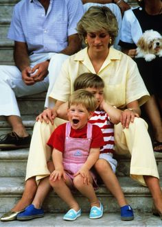August 1987 So adorable—a quick snap in Majorca, Spain with sons Prince William and Prince Harry.
