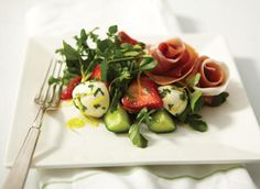 Bocconcini, prosciutto and strawberry salad. This elegant entree is a standout thanks to its colour and freshness. The flavours of strawberries, prosciutto, watercress and bocconcini marry to make a refined and enjoyable dish.