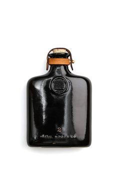 The Ceramic Flask is a drinking flask made with quarter inch ceramic white slip cast and accented with 2 leather straps, brass stud and brass button. Specs The flask is x inc Cigars And Whiskey, Pipes And Cigars, Modern Ceramics, Ceramic Design, Bottle Design, Ceramic Pottery, A Table, Packaging Design, Product Packaging