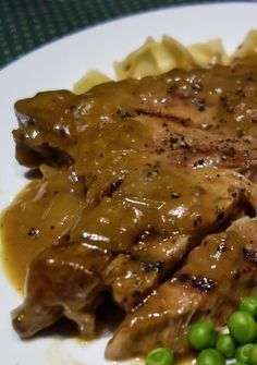 pork chop recipes These fall off the bone pork chops are fork tender and incredibly moist. Smothered in a thick rich onion gravy, this sure to please one-skillet dish is amazingly simple to prepare, a Pork Chop Recipes, Meat Recipes, Crockpot Recipes, Cooking Recipes, Recipies, Pernil, Pork Ham, Pork Ribs, Chops Recipe