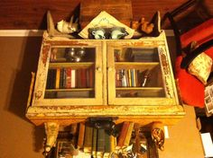 Old kitchen cabinet repurposed as a bookcase.