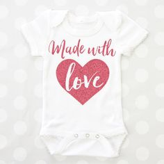 This adorable baby bodysuit can be customized with your favorite vinyl and onsie color.