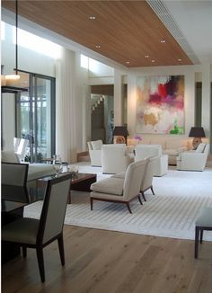 love the bold art, inset wood ceiling, neutral simple furnishings