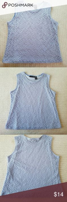 ICE BLUE LACEY AND FEMININE TANK TOP L IMPRESSIONS ICE BLUE LACEY AND FEMININE TANK TOP.  This top has a jewel neckline and is fully lined.  Will look great as an addition to most outfits.  Appropriate for the office or casual.  Super cute!  L Impressions  Tops Tank Tops