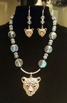 Leopard necklace  and earrings set. Gold/copper tone leopard faces. Beautiful glass beads. Stunning
