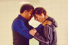 Cinna and Katniss in The Hunger Games