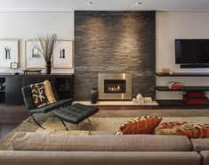 Mid-century modern ranch house renovation This is the exact look we are going for in our home. :) This courtyard house project involves the renovation of a mid-century modern ranch house by Bruns Architecture in Madison, Wisconsin. Home Interior Design, Fireplace Design, Modern Stone Fireplace, Cozy House, Living Room With Fireplace, Contemporary Living Room, Contemporary Living Room Design, Contemporary Fireplace, Fireplace Surrounds